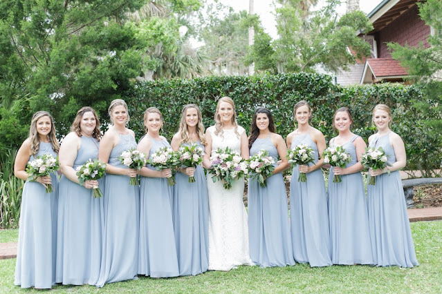 bridal party in dusty blue gowns