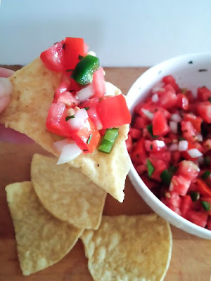 Easy and fresh Pico de Gallo is amazing with tortilla chips or as a garnish! Get the recipe at DIY beautify!