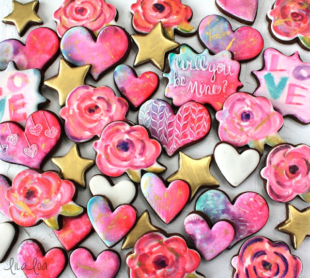 Decorated Valentine's Day watercolor sugar cookies -- roses, hearts, and gold stars