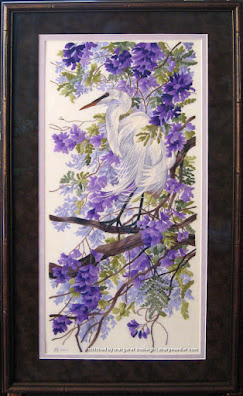 Completed and framed thread painted (with crewel wool) bird and jacaranda from Elsa Williams' 'Enchanted April'