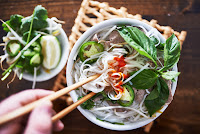 image of a bowl of colorful pho
