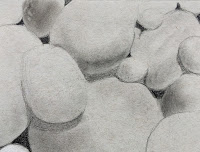 Charcoal drawing of pebbles on Strathmore gray toned paper