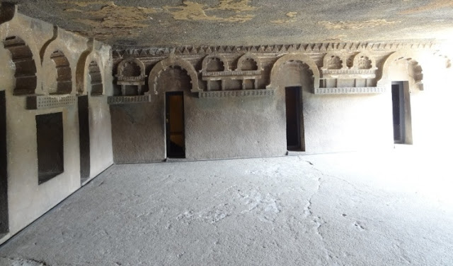 Interior of Ajanta cave 12 - each door leads to a cell