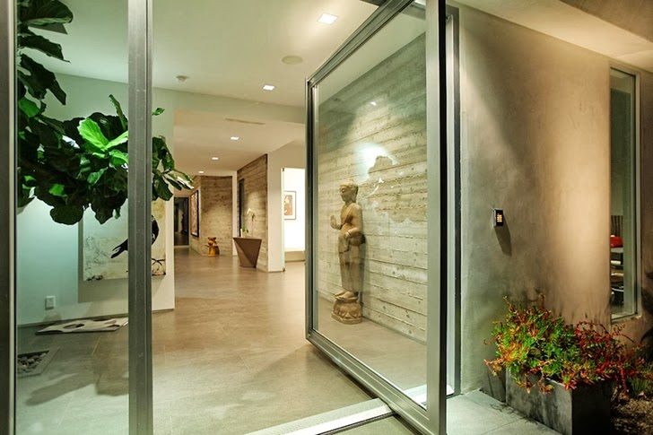 Open glass door on Modern Beverly Hills House with open interiors