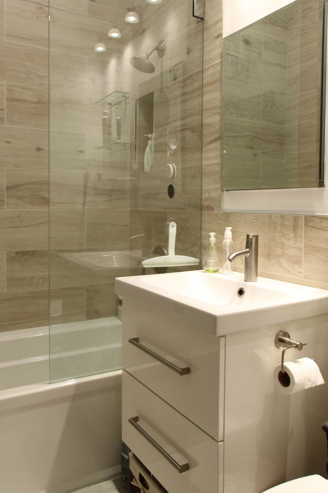 built in recessed storage in the shower european style glass panel instead of a shower curtain super easy to clean