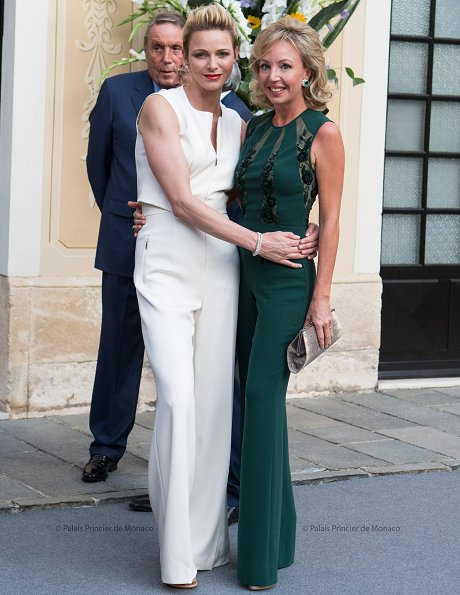 Prince Albert and Princess Charlene held a reception for 75th Monaco Grand Prix Formula 1 at Principality Palace. Princess wore Akris Pantsuit