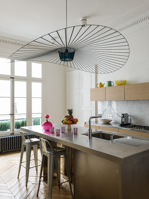 vetigo pendant in a modern kitchen in paris with chevron floor