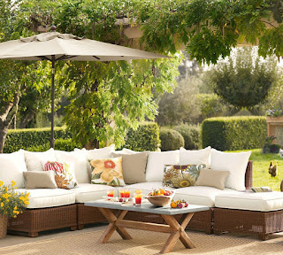 calming brown pottery barn patio mixed with wicker sectional sofa and topiary garden boundary