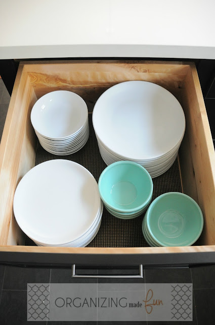 Organized dinnerware in a drawer :: OrganizingMadeFun.com