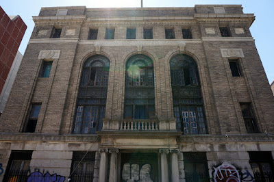 Abandoned neoclassical brick Masonic Temple facade