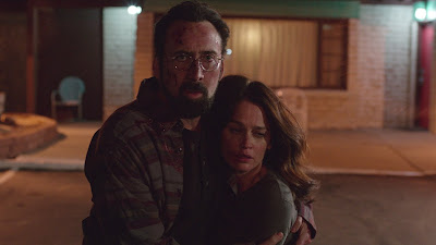 Nicolas Cage and Robin Tunney in Looking Glass