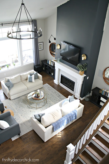 Super tall fireplace wall in dark gray paint