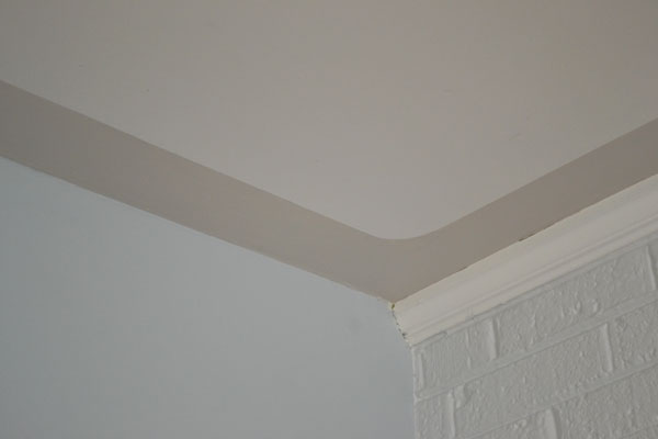 Paint splotches on the ceiling? Hide them with a border ...