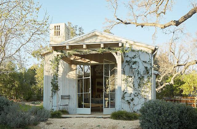 Steel doors open to porch modern farmhouse neutral European antique style Patina Farm Giannetti Home
