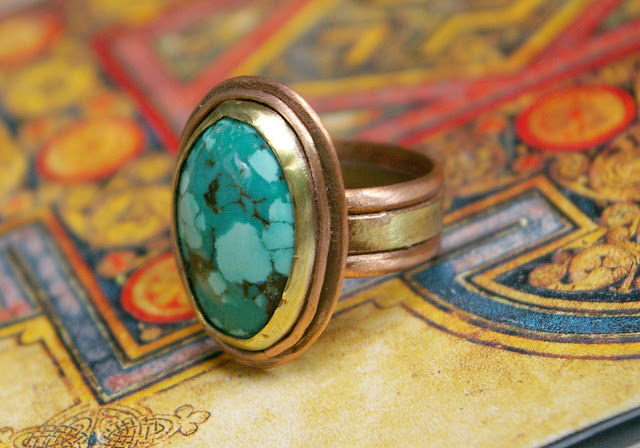 https://www.etsy.com/ca/listing/628106459/tibetan-turquoise-ring-mixed-metal