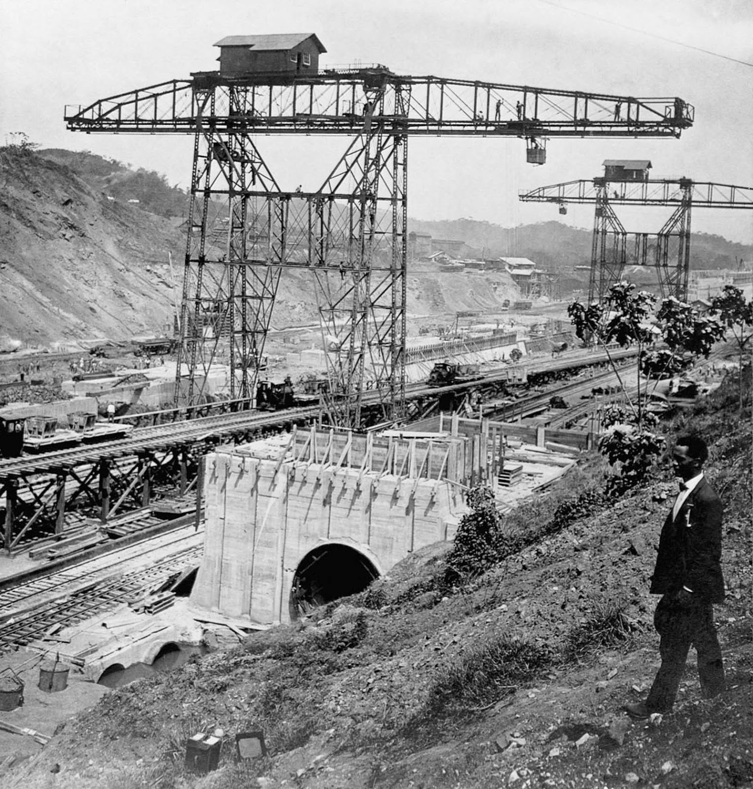 A man stands on the west bank overlooking the construction of the Pedro Miguel Locks. 1910.