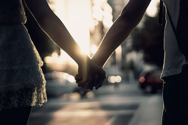 Holding a loved one's Hand Relieves pain and stress
