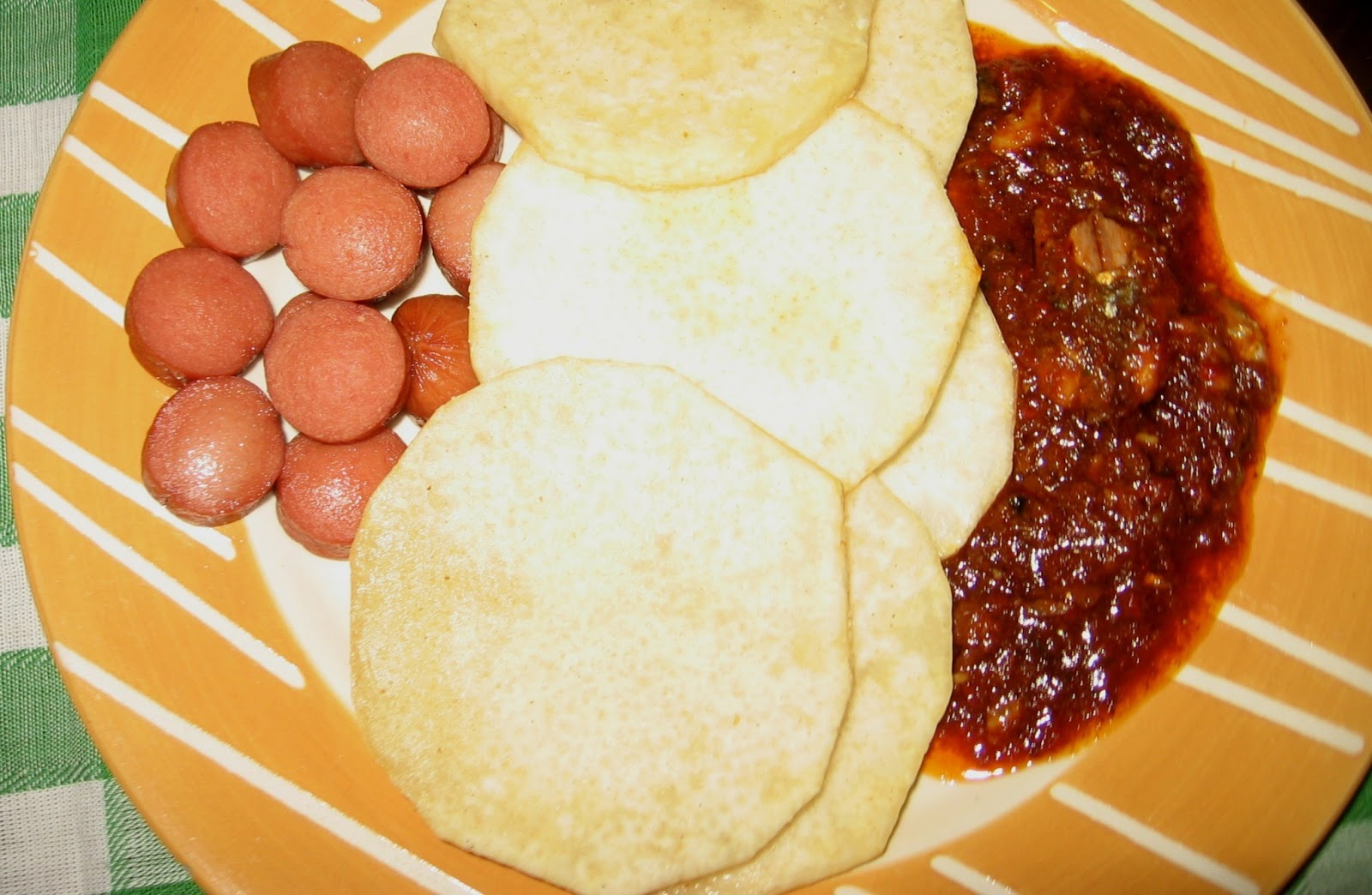 Nigerian Fish Tomato Stew With Fried Yam, Sausages