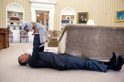 In the Oval Office President Obama lifts Ella Rhodes in her elephant costume that she is wearing for a Halloween event at the White House on October 30, 2015. Photo Pete Sousa.
