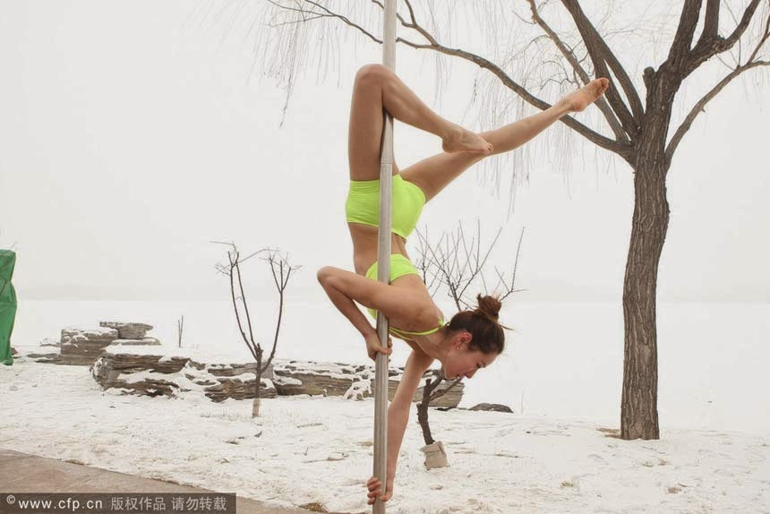 Pole dancers brave cold to make point