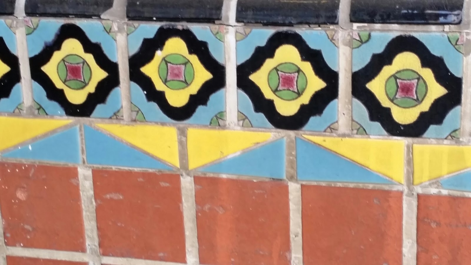 Bright colors on the tiles date the tiles to the early 1900s