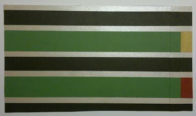 """""""Strimmelkortet"""" Strimler af  farvet papir er limet på et stykke  genbrugskarton med dobbeltklæbende tape. Genbrugskartonen er i dette tilfælde  en tom Galle & Jessen pålægchokolade æske med målene 20,02 x 12,7cm"""