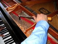 piano technician tuning piano strings