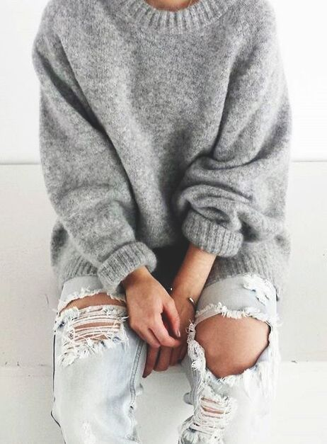 cashmere sweater and distressed jeans