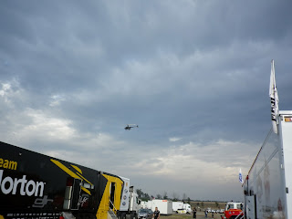 CHOPPER FLYING OVER RACES