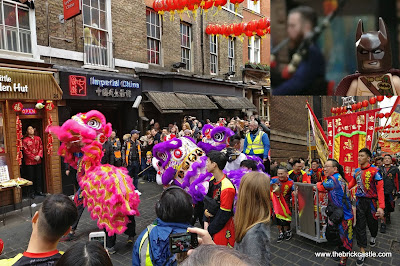 London Chinese New Year parade Dragons chasing cabbage