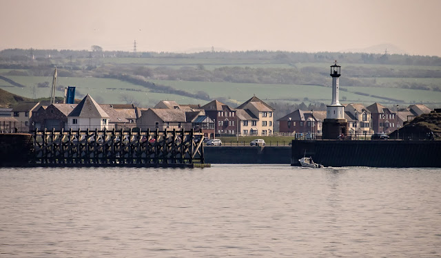 Photo of a small fishing boat returning to Maryport from the Solway Firth