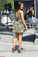 Priyanka Chopra looks super cute in happy mood wearing a short flower print dress in Hollywood 003.jpg