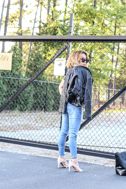 Ripped jeans and black moto Jacket