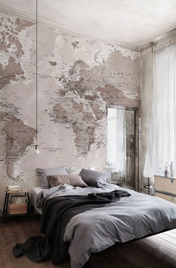 neutral palette with map wall in bedroom