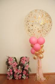 Flower monogram and big confetti balloon for party decoration