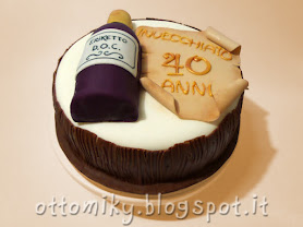infine abbiamo rivestito il bordo della torta con assi di legno realizzate in goloso cioccolato plastico