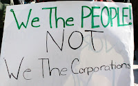 sign saying, we the people, not we the corporations