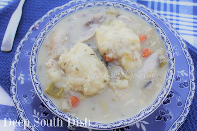 From scratch, chicken and dumplings, made in a slow cooker and using a whole chicken for a homemade stock, a creamy roux base and drop dumplings.