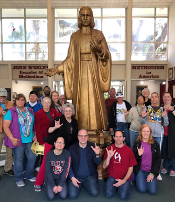 Many of the SEJ group posed for a picture a large John Wesley statue that is made of chocolate.