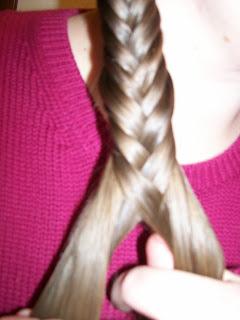 """Braiding hair in """"Grecian plaits""""."""