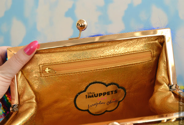 zipped pocket and Irregular Choice Disney Muppets branding inside handbag