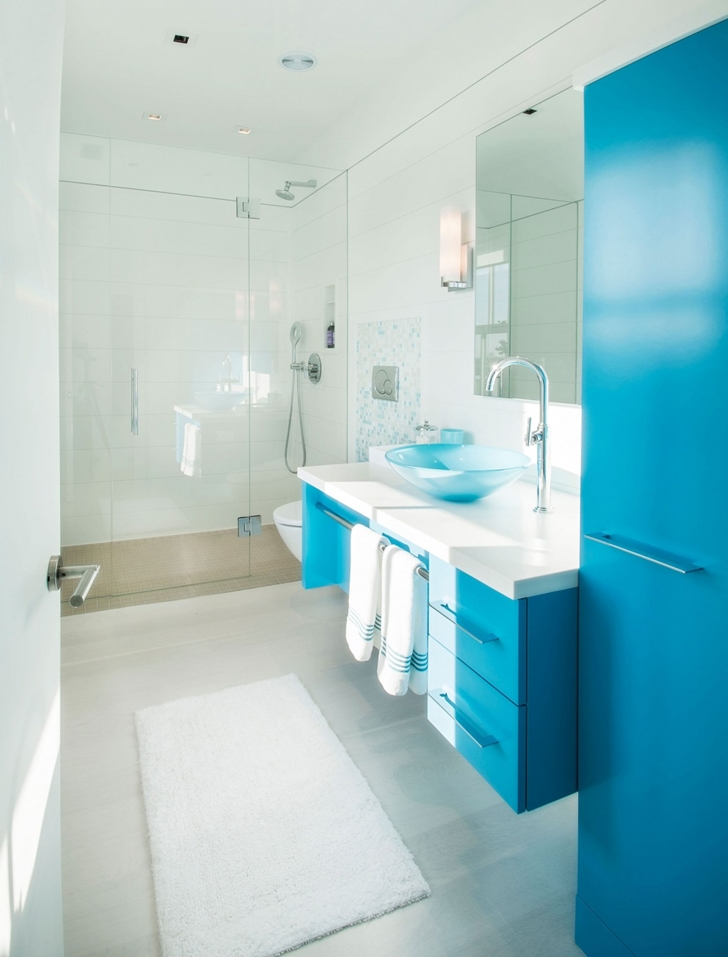 Blue bathroom furniture in Contemporary style home on the beach