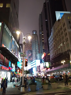 Typical New York City, busy, tall buildings, everything lit up