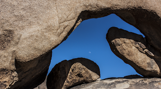the arch and moon at joshua tree national park