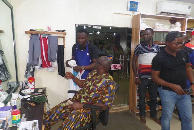 Governor Fayose spotted having a hair cut at a down town Barbing Salon in Ado-Ekiti