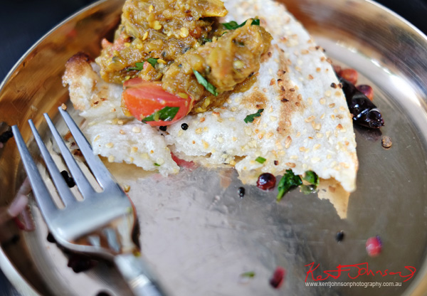 Eggplant Bharta resting on garlic Naan; Smoked eggplant mashed with onion, tomatoes chillies and spices at Masala Theory, Surry Hills, . Photographed by Kent Johnson for Street Fashion Sydney.