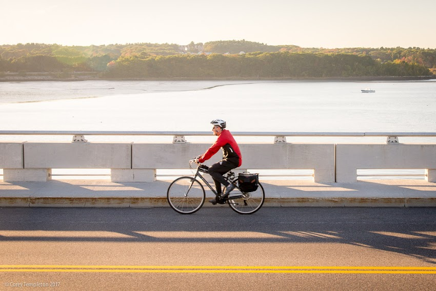 Portland, Maine USA October 2017 photo by Corey Templeton. A fellow bike commuter crossing the Martin's Point Bridge on a picturesque afternoon.