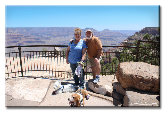 Husband and wife with Basset & Westie at the Grand Canyon