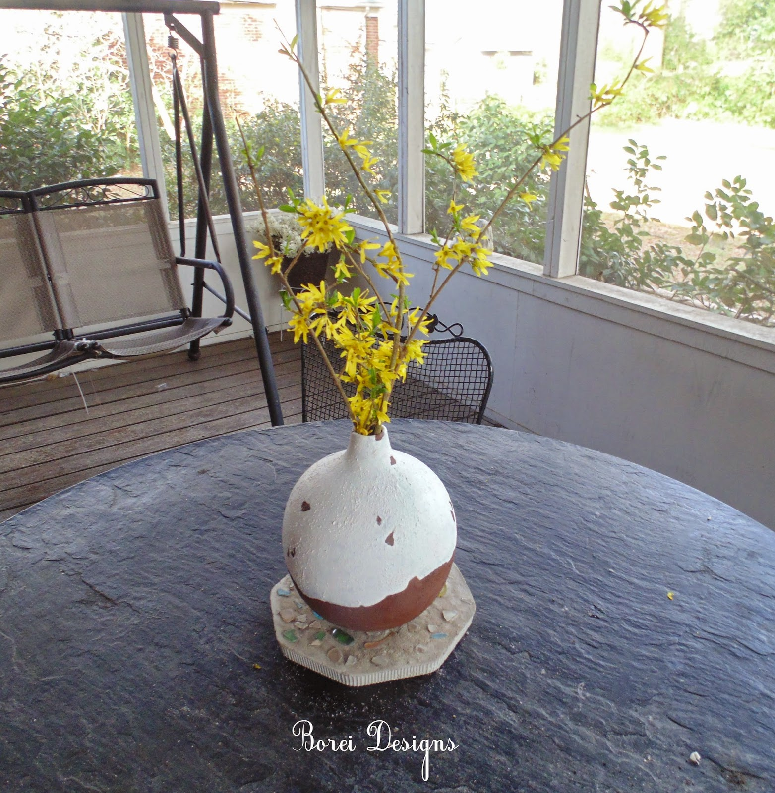 How to upcycle old ceramic containers with a tuscan urn look.