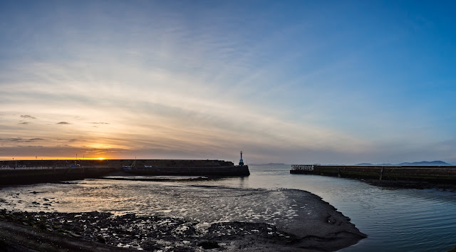 Photo of the view across Maryport basin to the old lighthouse